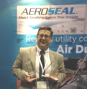 "Aeroseal's Neal Walsh at AHR EXPO with both the AHR Award in the Ventilation category and the ""Best of Show"" Product of The Year Award."